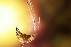 White wine being poured in wineglass