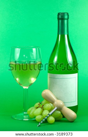 White wine bottle,glass grapes and corkscrew on a green background. Blank wine label.