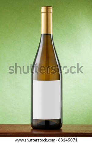White wine bottle on green background with blank label