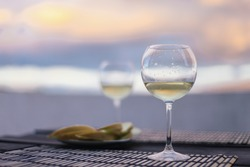 White wine, cheese plate. Dinner on sunset with amazing view on mountain Pico, Azores, Portugal, Europe