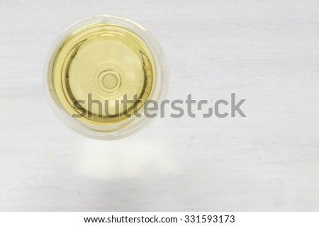 White wine glass on a white background top view