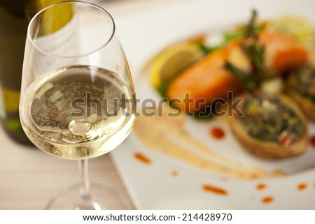White Wine Glass. Salmon Steak on a Background