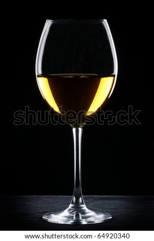 White wine glass silhouette over black background - stock photo
