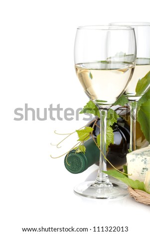 White wine glasses and cheese. Closeup. Isolated on white background