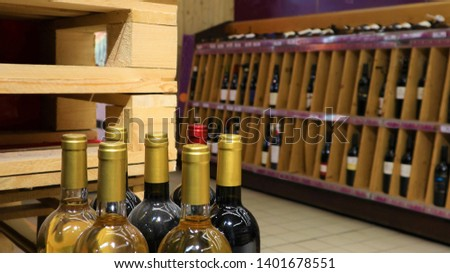 white wine in bottles in wine shopRed and white wine in bottles in wine shop #1401678551