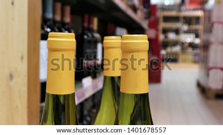 white wine in bottles in wine shopRed and white wine in bottles in wine shop #1401678557