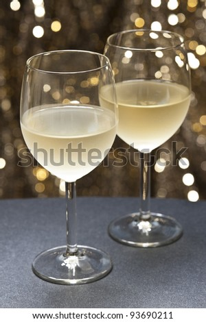 White Wine in front of beautiful gold glitter background