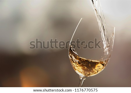 White wine splash isolated on background #1176770575