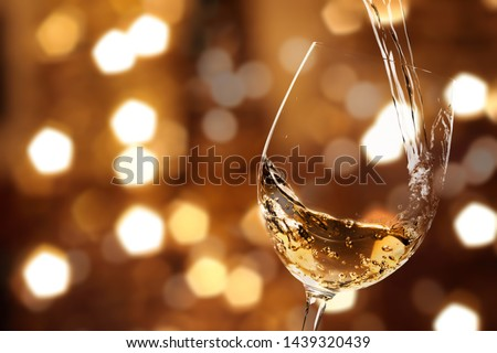 White wine splash isolated on background #1439320439