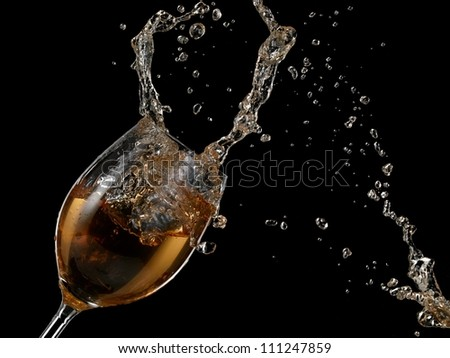 White wine splash with drops - stock photo