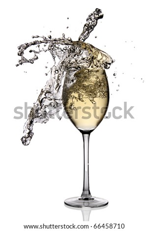 White wine splashing out of glass