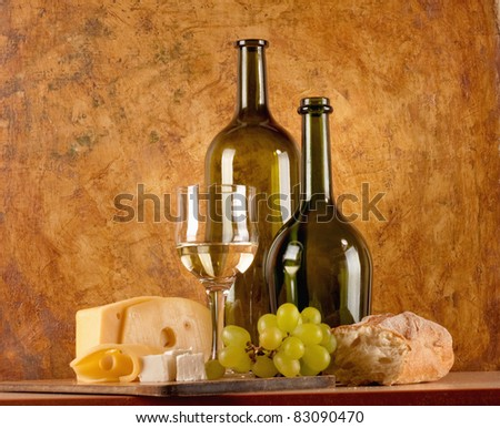 white wine with different sorts of cheese