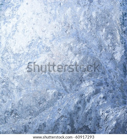 White wintry hoarfrost background on a window