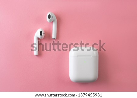 white wireless headphones on pink background. female headphones. copy space. female headphones. Copy Space