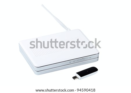 White wireless router and usb modem isolated on a white background