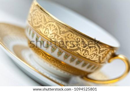 White with golden pattern tea set