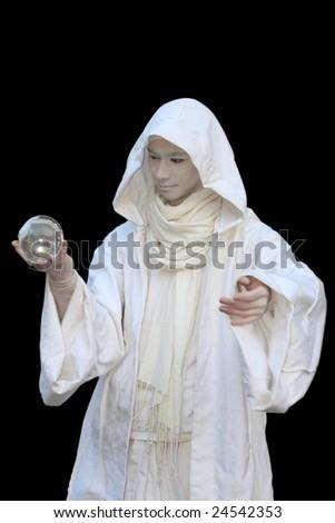 White Wizard manipulating crystal balls  isolated on black background