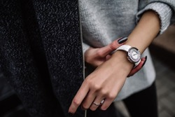 white women's wrist watch on the girl's hand