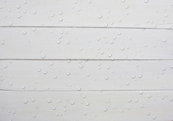 White wood background and add water drops graphics on wood. /background