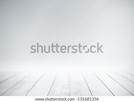 White wood floor with surfing wave background. Blue cool water and sky bright rays light. Nature wallpaper blur of sea daytime. Focus to wooden in the foreground. Timber pattern texture stage.