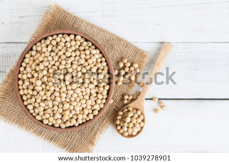 White wood floor with wooden cup with soybean,top view and copys pace,soybeans in wooden bowl with wooden spoon on table wooden
