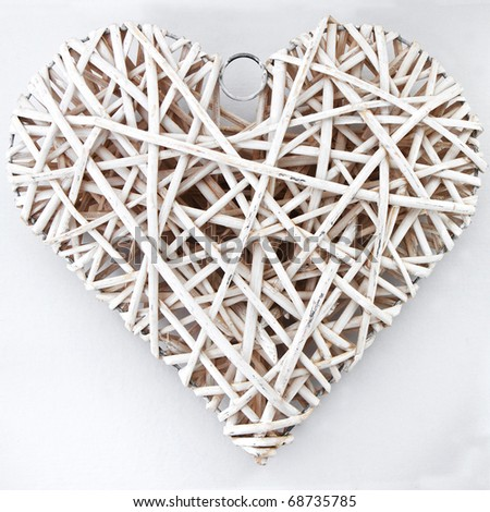 White wood heart isolated on a background