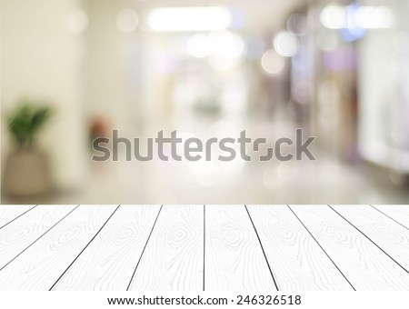 White wood perspective and blurred store with bokeh background, product display template.