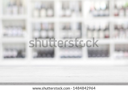 White wood Table Top Reception Counter or Cash Counter Restaurant or coffee cafe blurred showcase background for montage product present