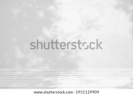 White Wood Table with Bamboo Tree Shadow on Concrete Wall Texture Background, Suitable for Product Presentation Backdrop, Display, and Mock up.