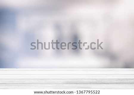 White Wood Table with Blurred White Room Background, Suitable for Product Display and Business Concept. #1367795522