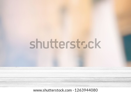 White Wood Table with White Bokeh of Interior Room Background, Suitable for Product Display. #1263944080