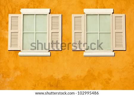 White wood windows on colorful wall