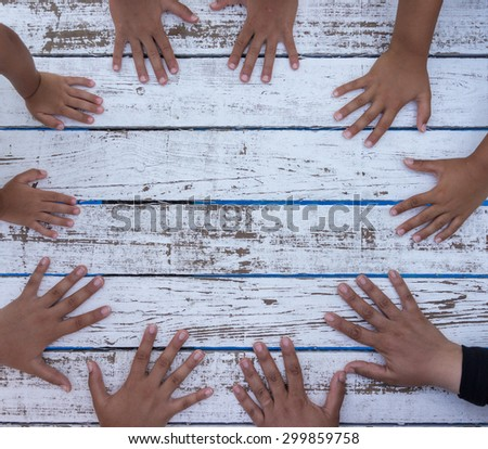White wood with hands circle copy space - Shutterstock ID 299859758