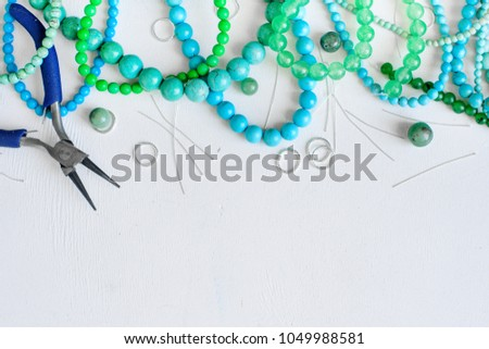 white wooden background with many colorful beads