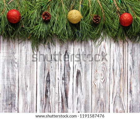 white wooden background with spruce branches and Christmas balls, place for the inscription, blank for inscription, the New Year holidays #1191587476