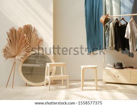 white wooden barstool and white round white mirror frame #1558577375