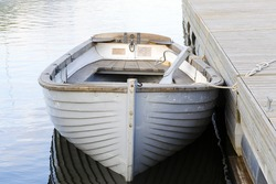 White wooden boat moored at the wharf