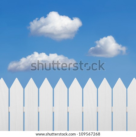 White wooden fence against blue sky with copy space
