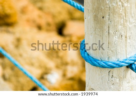 White wooden fence with rope