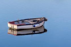 white wooden fishing boat in a calm sea