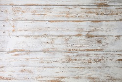 White wooden floorboards. Distressed worn floorboard background painted white