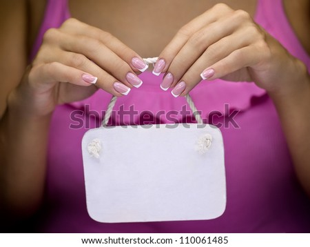 White Wooden nameplate in women's hands