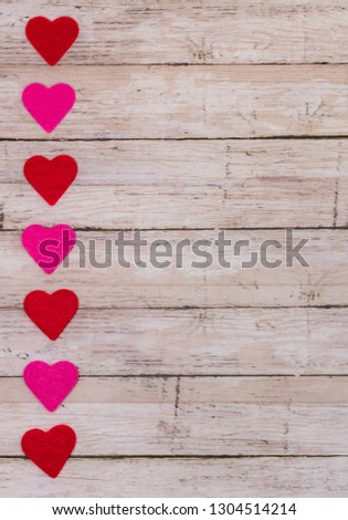 White wooden Saint Valentine's day background with red and pink hearts, vertical orientation, card format, copy space, copy space. Symbol of love, Love concept, top view, flat lay #1304514214