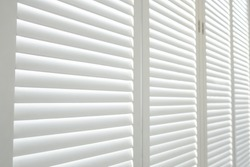 White wooden shutters, White wooden blind.