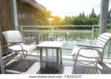 white wooden table and chairs...