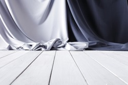 White wooden table and gray textile background