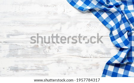 White wooden table covered with blue tablecloth. View from top. Empty tablecloth for product montage. Free space for your text Stock photo ©