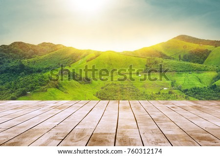 white wooden table top with the mountain landscape