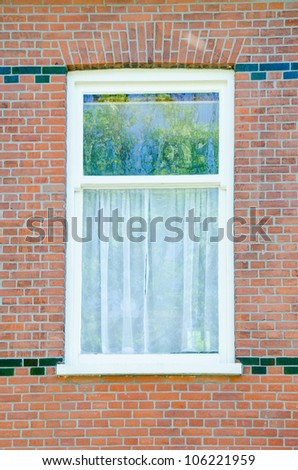 White wooden window on brick wall