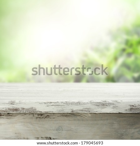 white worn table and green space